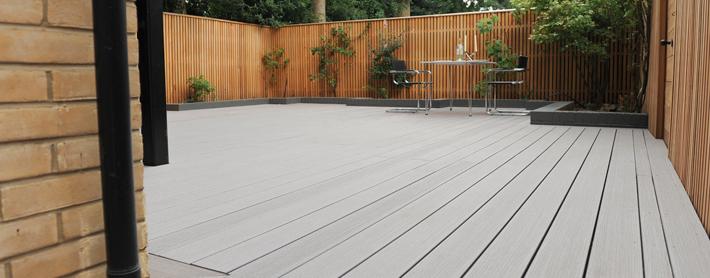 Beautiful composite grey decking in a garden