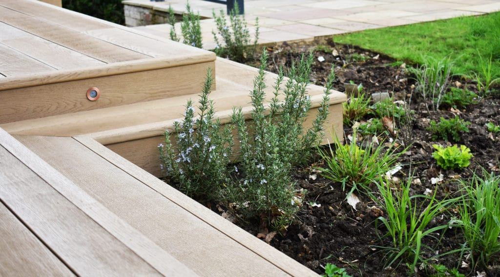 golden oak millboard steps with lights and plants
