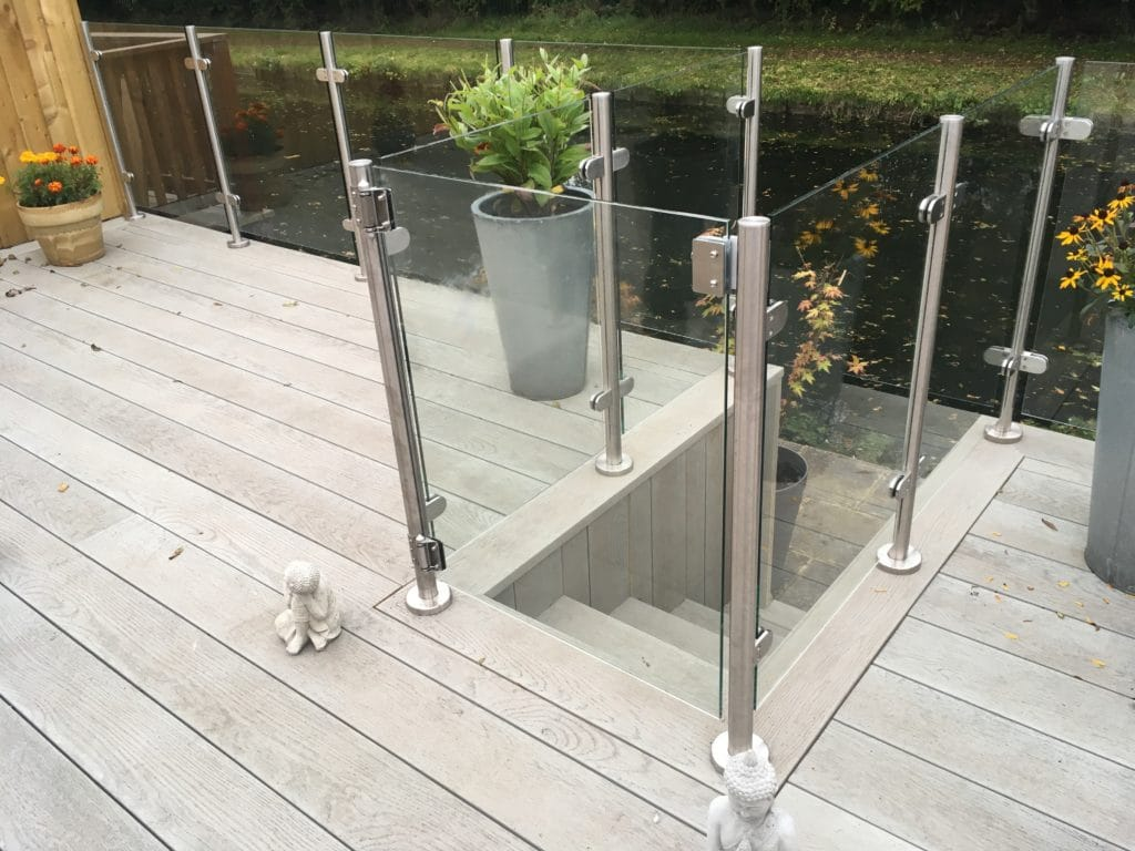 millboard smoked oak decking and glass balustrade