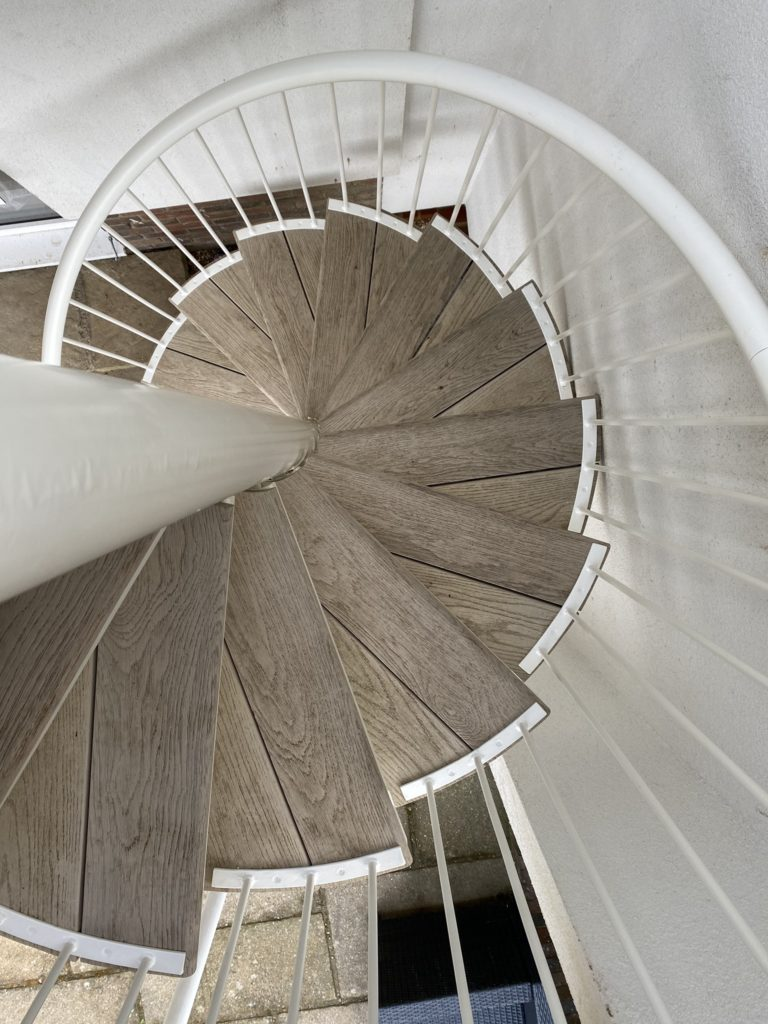 millboard decking spiral staircase smoked oak